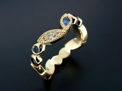 18kt Yellow Gold Rub Over and Filigree Design Comprising Marquise Sapphires and Diamonds and Round Sapphires and Amethysts.