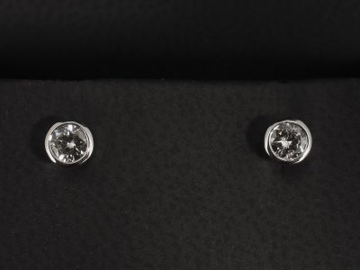 Round Brilliant Cut Diamond 0.42ct (2) Stud Earrings Set in 18kt White Gold in a Rubover Set Design