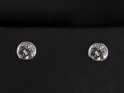 Round Briliant Cut Diamond 0.84ct (2) Stud Earrings Set in 18kt White Gold in a Rubover Set Design