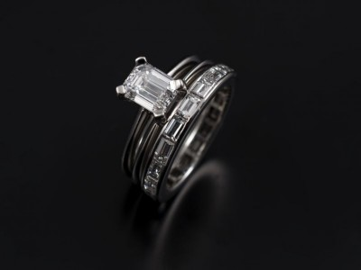 Emerald Cut 1.01ct D VVS2 with integrated spacer wedding ring and a full eternity ring. All hand made in platinum.