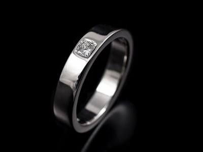 Ladies Platinum Wedding Ring with a 0.08ct F VS Princess Cut Diamond Secret Set into Band.