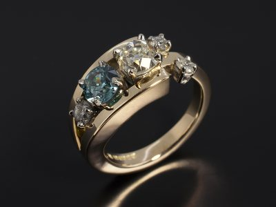 Palladium and 9kt Yellow Gold Split Band Dress Ring with Round Brilliant Cut Diamonds and Blue Zircon.