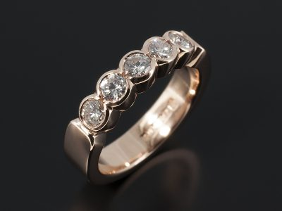 Eternity Ring with Round Brilliant Diamonds 0.57ct Total F VS in a 9kt Rose Gold Half Rub Over Set Design.