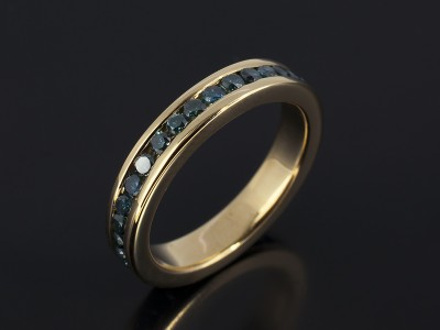 Round Brilliant Blue Diamond Full Channel Set Eternity Ring in 9kt Yellow Gold.
