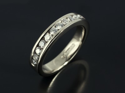 Channel Set Half Eternity Ring with 0.70ct Total F VS Round Brillian Diamonds in 18kt White Gold.