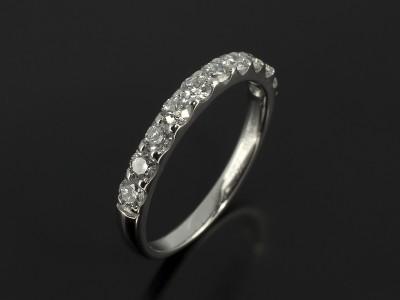Diamond Claw Set Platinum Wedding Ring.