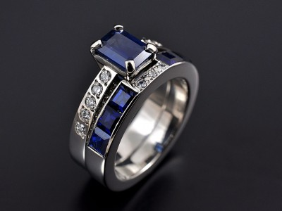 Emerald Cut Sapphire 1.34ct with Pave Set Diamond Shoulders and Fitted Sapphire Channel Set Wedding Ring. Both Hand Made in Palladium.