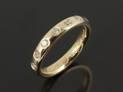 Eternity Ring 18kt Yellow Gold with Secret Set Round Brilliant Diamonds.