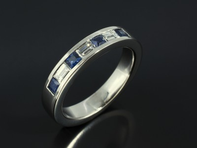 Ladies Channel Set Platinum Diamond Baguette and Princess Cut Sapphire Wedding Ring.