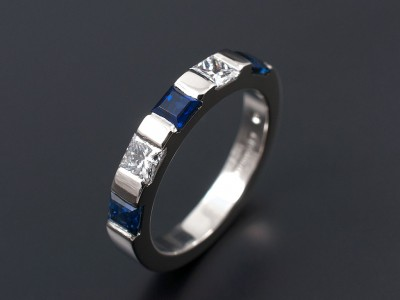 Ladies Wedding Eternity Ring Comprising 2 x 0.10ct F VS Princess Cut Diamonds and 3 x 3mm Square Ceylonese Sapphires. Hand Made and Bar Set in Palladium.