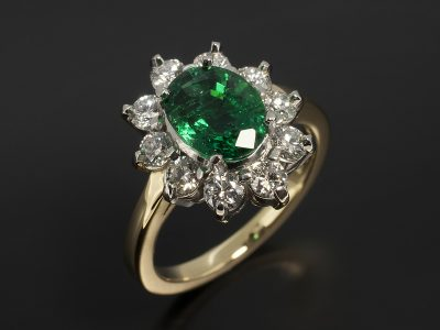Oval Cut Emerald 1.66ct with Round Brilliant Cut Diamonds 0.85ct Total F Colour VS Clarity Min in an 18kt Yellow Gold and Platinum Cluster Setting.