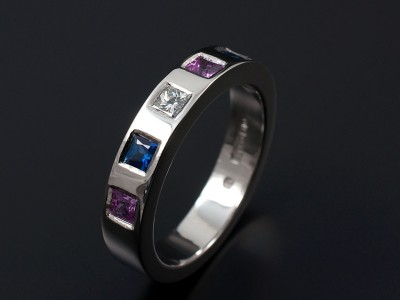 Palladium Eternity Wedding Ring Consisting of a 0.10ct F VS Princess Cut Diamond, 2 x Blue Square Sapphires and 2 x Pink Square Sapphires Secret Set into Band.