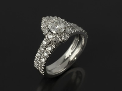 Pear Cut 0.46ct H Colour VS Clarity in a Platinum Diamond Claw Set Halo Design with Fitted Wedding Ring.