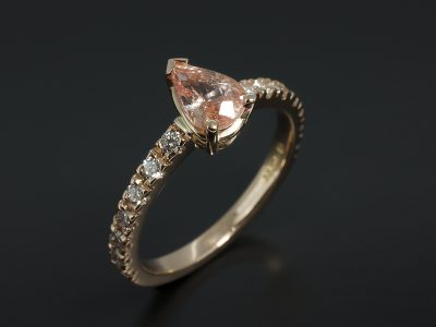 Pear Cut Peach Sapphire 0.91ct in an 18kt Rose Gold Diamond Claw Set Design.