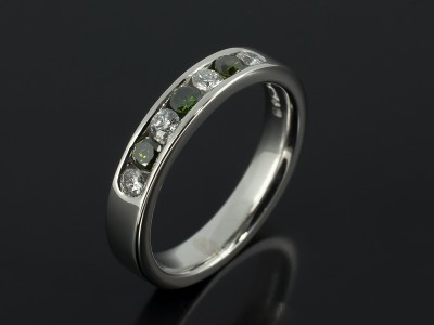 Platinum Green and White Diamond Channel Set Eternity Ring.