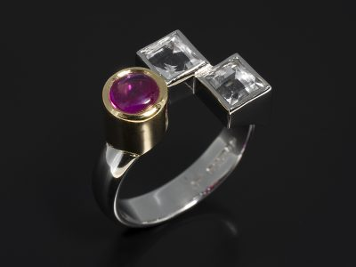 Cabochon Cut Ruby 0.76ct and Step Cut White Sapphite 1.45ct (2) Rubover Set in 18kt Yellow Gold and Platinum in a Dress Ring Design