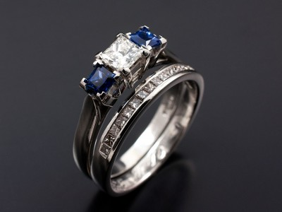 Princess Cut 0.40ct G VS1 with 2 x 0.25ct Square Sapphires in a Platinum 4 Claw Trilogy Setting with Matching Channel Set Platinum Wedding Ring.