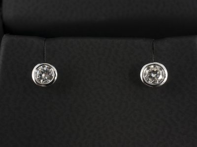 Round Brilliant Cut Diamond Earrings 0.40ct Total F VS in 9kt White Gold Rub Over Settings.
