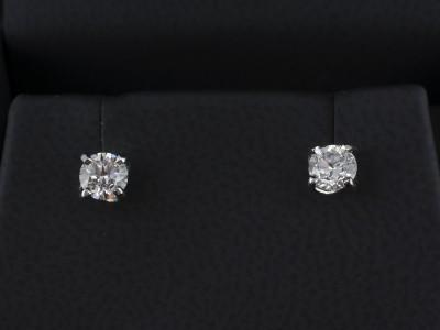 Round Brilliant Cut 0.30ct E Colour SI2 Clarity Platinum Twist Set Earrings.