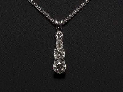 Round Brilliant Cut Diamond Graduated Pendant 0.72 ct (4) Set in 9kt White Gold in a Claw Set Design