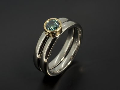 Round Brilliant Cut Blue Diamond 0.40ct in a Palladium and 18kt Yellow Gold Rub Over Set Design with Fitted Wedding Ring.