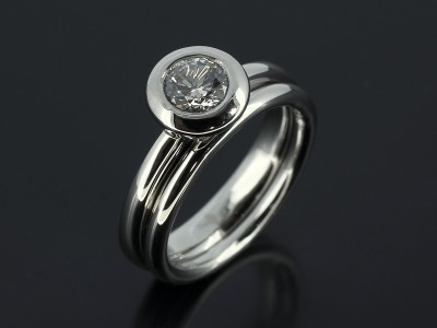 Round 0.57ct H Colour SI2 Clarity in a Platinum Rub Over Setting with Fitted Wedding Ring