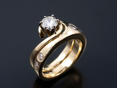 Round Brilliant 0.51ct F SI1 in a 18kt Yellow Gold Twist Setting with Fitted Secret Set Diamond Wedding Ring