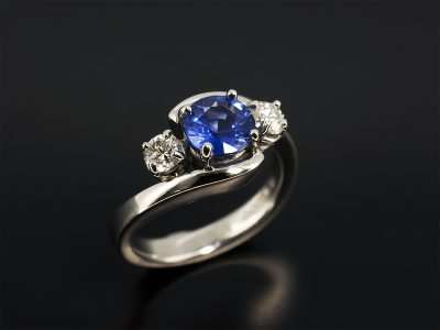 Round Brilliant Cut Sapphire 1.24ct with Round Brilliant Cut Diamonds 0.30ct (2) Set in Platinum in a Trilogy Twist Design