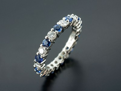 Round Brilliant and Sapphire Full Platinum Eternity Ring.