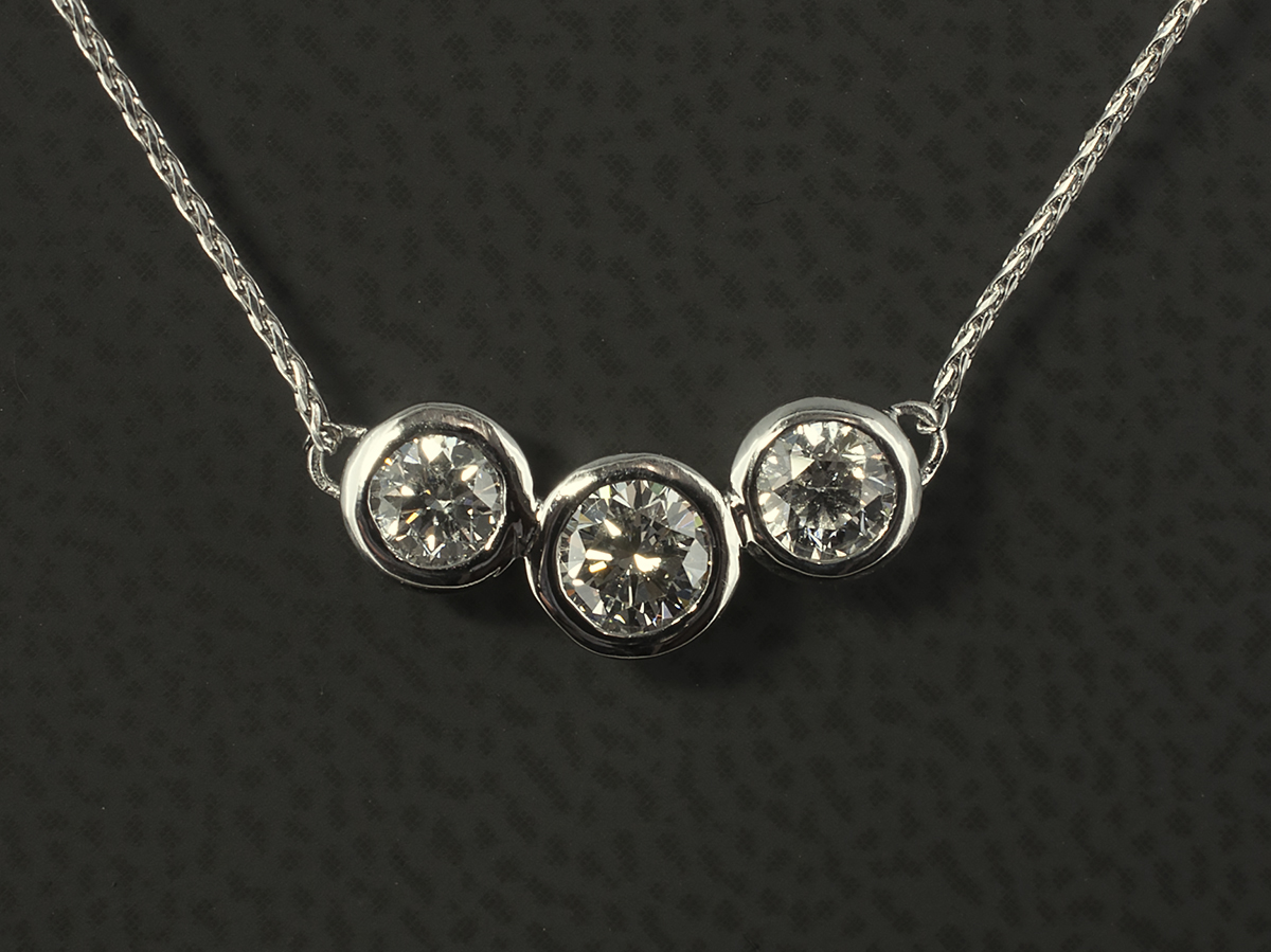 Hand made diamond and precious stone pendants glasgow west end pendant with round brilliant cut diamonds in an 18kt white gold rub over set trilogy design audiocablefo