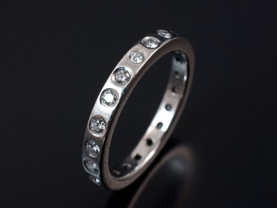 Round Brilliant Cut Secret Set Full Wedding Ring in Platinum