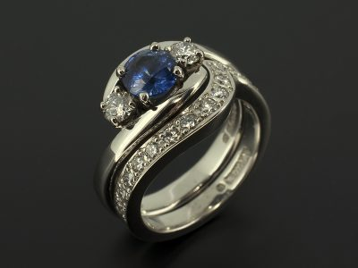 Round Sapphire 0.90ct with Round Brilliant Diamonds 0.30ct F VS with a Fitted Pavé Set Diamond Palladium Wedding Ring.