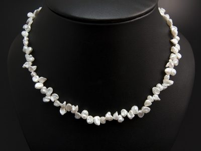 White Freshwater Keshi Pearl Necklace With Silver A Carabiner Clasp. Available In Store £160.00