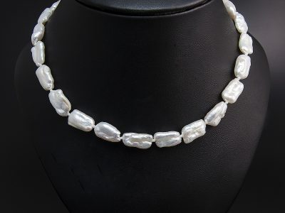 White Rectangular Shape Freshwater Pearl Necklace With A Silver Oval Magnetic Clasp. Available in Store £160.00
