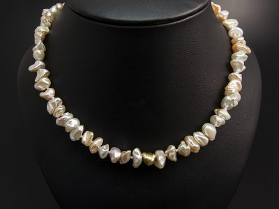 Peach Freshwater Keshi Pearl Necklace With A Silver Patterned Magnetic Clasp. Available in Store £280.00