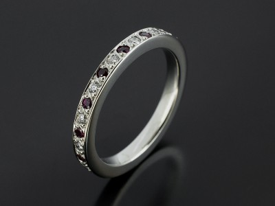 Ladies Diamond and Ruby Platinum Pave Set Wedding Ring.
