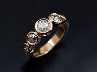 Round Brilliant Five Stone Rub Over Engagement / Eternity Ring Comprising 0.41ct, 2 x 0.30ct and 2 x 0.15ct G VS Diamonds Hand Made in 18kt Yellow Gold.