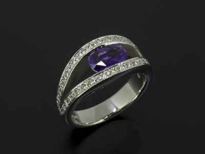 Oval Cut Purple Sapphire, 1.41ct Tension Set in Platinum With a Round Brilliant Cut Diamond 0.42ct (40) Pave Set Design