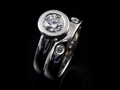 Platinum Round Brilliant Engagement Ring: 1.00ct F VS2 with a Matching Integrated Platinum Wedding Ring with 2 x 0.04ct F VS Round Brilliants Secret Set into Band.