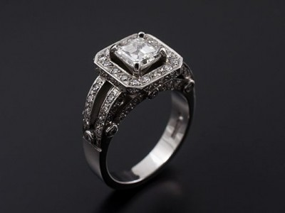 Asscher 0.81ct E VS1in a Platinum Hand Made Pave Set Halo Design