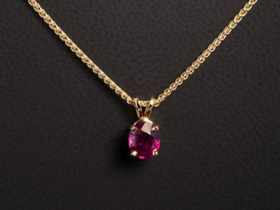 18kt Red/Rose Gold 4 Claw Pendant with Double Bale and Spiga Chain. Oval Cut Ruby 0.63ct.