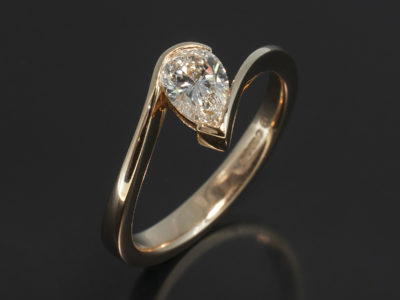 Pear Cut 0.52ct I Colour VS1 Clarity in a 18kt Rose / Red Gold Half Rub Over Set Twist Design Solitaire.
