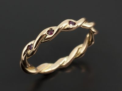 18kt Rose Gold Twist Wedding Ring with Secret Set Rubies.