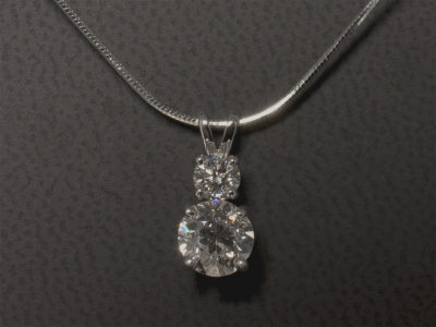 18kt White Gold 4 Claw Set Pendant with Omega Cable. Round Brilliant Cut Diamonds 1.08ct and 0.25ct F Colour SI Clarity Min.