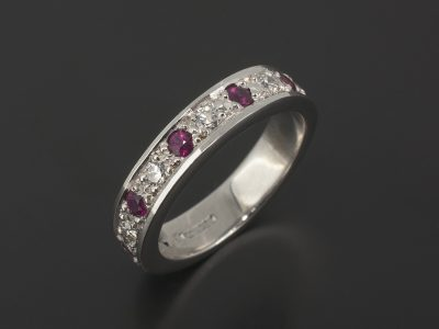 18kt White Gold Wedding / Eternity Ring with Pavé Set Round Brilliant Cut Diamonds and Rubies.