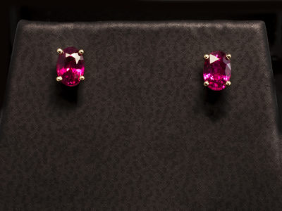 18 kt Yellow Gold Four Claw Set Design Earrings with Oval Cut Rubies 0.63ct Total.