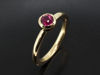 18kt Yellow Gold Rubover Set Design Round Ruby, 0.54ct