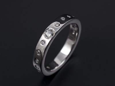 Secret Set Wedding / Eternity Ring Comprising 1 x 0.10ct F VS and 22 x 1.2mm Round Brilliant Diamonds. Hand Made in Platinum.