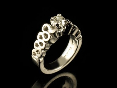 White Gold 18kt Wave Engagement Ring with a 0.51ct E VS2 Round Brilliant Diamond