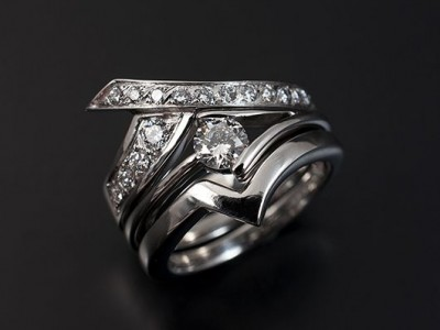 Fitted Eternity and Wedding Ring. 18kt White Gold with Pave Set Round Brilliant Diamonds.
